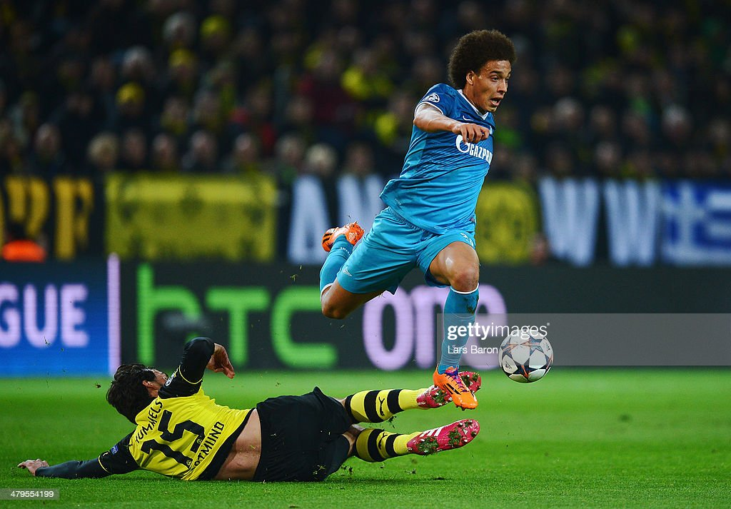 <a gi-track='captionPersonalityLinkClicked' href=/galleries/search?phrase=Axel+Witsel&family=editorial&specificpeople=4345455 ng-click='$event.stopPropagation()'>Axel Witsel</a> of Zenit is tackled by <a gi-track='captionPersonalityLinkClicked' href=/galleries/search?phrase=Mats+Hummels&family=editorial&specificpeople=595395 ng-click='$event.stopPropagation()'>Mats Hummels</a> of Dortmund during the UEFA Champions League round of 16, second leg match between Borussia Dortmund and FC Zenit at Signal Iduna Park on March 19, 2014 in Dortmund, Germany.