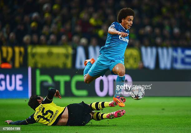 Axel Witsel of Zenit is tackled by Mats Hummels of Dortmund during the UEFA Champions League round of 16 second leg match between Borussia Dortmund...