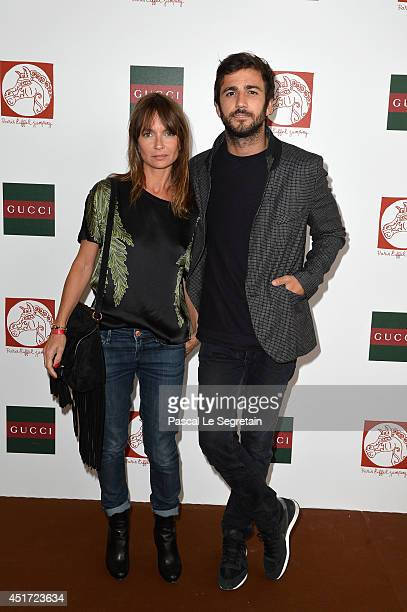 Axelle Laffont and Cyril Paglino attend the Paris Eiffel Jumping presented by Gucci at ChampdeMars on July 5 2014 in Paris France