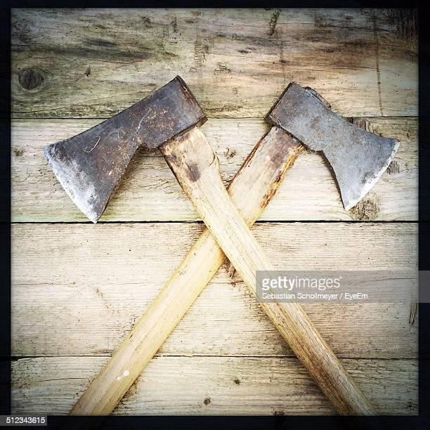 Axes on wooden wall