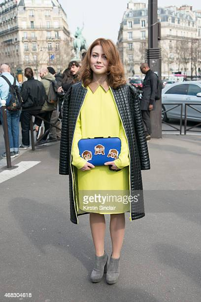 Axinia Vine wears own design bag Micheal Kors shoes and Ra Nova Nover coat on day 9 of Paris Collections Women on March 11 2015 in Paris France