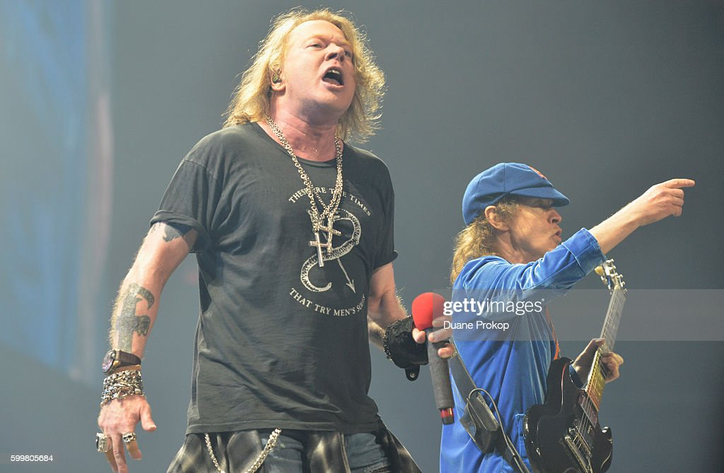 Axl Rose and Angus Young of AC/DC perform during the Rock Or Bust Tour at Quicken Loans Arena on September 6, 2016 in Cleveland, Ohio.