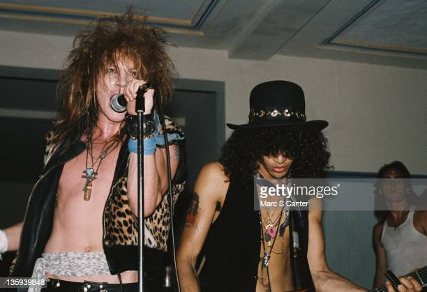 Axl Rose and Slash of the rock band 'Guns n' Roses' perform onstage at a UCLA frat party where they played 'Welcome To The Jungle' for the second...