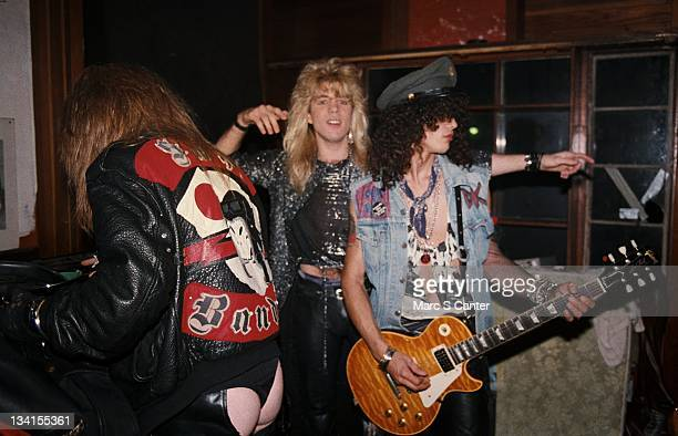Axl Rose Duff McKagan and Slash of the rock band 'Guns n' Roses' backstage just before they perform their first sold out show at The Troubadour on...