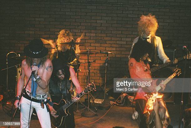 Axl Rose Izzy Stradlin Steven AdlerSlash and Duff McKagan of the rock band 'Guns n' Roses' perform onstage at the Troubadour where they played...