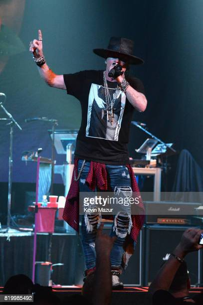 Axl Rose of Guns N' Roses performs onstage during SiriusXM's Private Show with Guns N' Roses at The Apollo Theater before band embarks on next leg of...