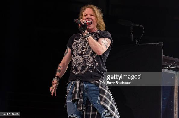 Axl Rose of Guns N' Roses performs with AC/DC during the Rock Or Bust Tour at The Palace of Auburn Hills on September 9 2016 in Auburn Hills Michigan