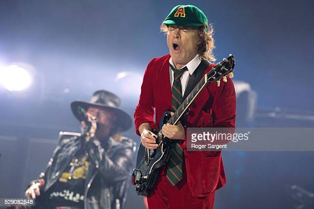 Axl Rose perfoms with Angus Young of AC/DC on the opening night of Rock or Bust Tour at the Passeio Maritimo De Alges on May 7 2016 in Lisbon Portugal