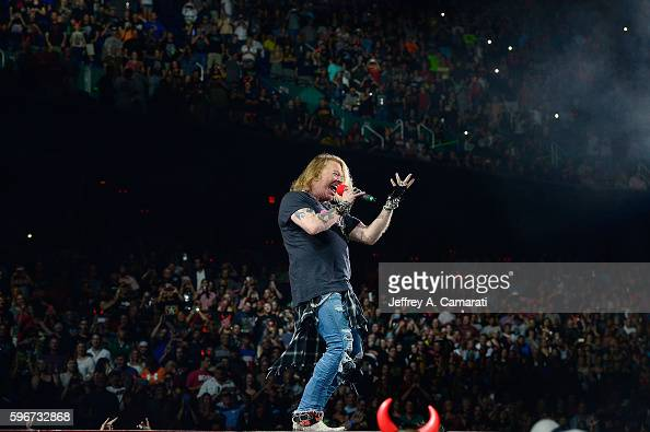 Axl Rose performs with AC/DC during the Rock Or Bust Tour at the Greensboro Coliseum on August 27 2016 in Greensboro North Carolina