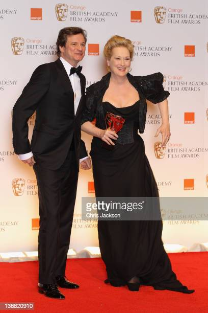 Axtor Colin Firth and Actress Meryl Streep pose in the press room with the Best Actress award for 'The Iron Lady'during the Orange British Academy...