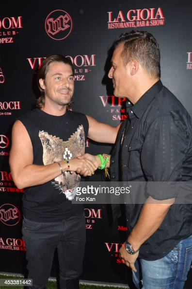 Axwell from Swedish House Mafia band and Jean Roch Pedri attend the Axwell Party At The VIP Room Saint Tropez on August 8 2014 in Saint Tropez France