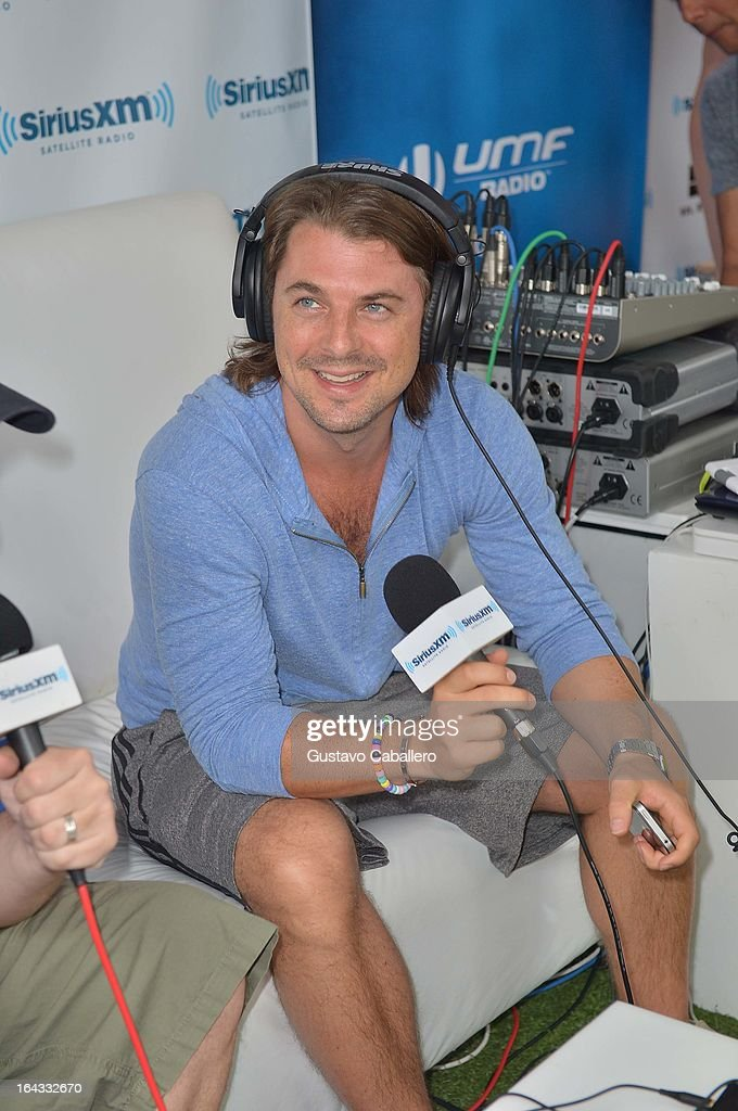 <a gi-track='captionPersonalityLinkClicked' href=/galleries/search?phrase=Axwell&family=editorial&specificpeople=5989822 ng-click='$event.stopPropagation()'>Axwell</a> is interviewed on SiriusXM's 'UMF Radio' at the SiriusXM Music Lounge at the W Hotel on March 22, 2013 in Miami, Florida.
