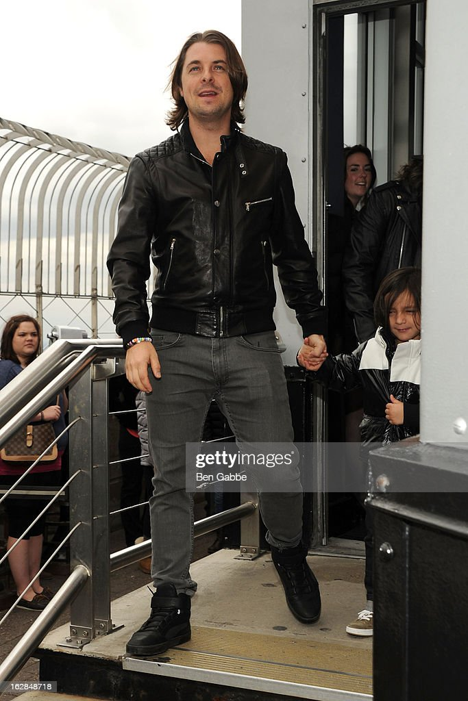 Axwell of the Swedish House Mafia lights The Empire State Building on February 28, 2013 in New York City.