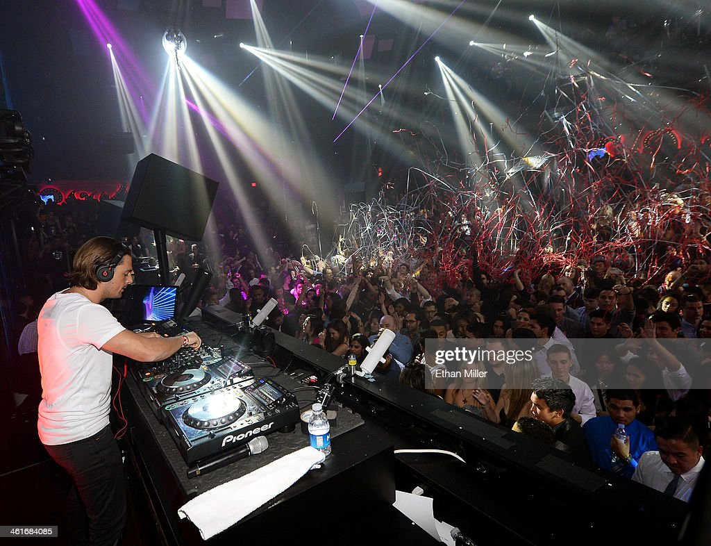 DJ <a gi-track='captionPersonalityLinkClicked' href=/galleries/search?phrase=Axwell&family=editorial&specificpeople=5989822 ng-click='$event.stopPropagation()'>Axwell</a> performs during a Beats by Dr. Dre CES after party at the Light Nightclub at the Mandalay Bay Resort and Casino on January 9, 2014 in Las Vegas, Nevada.