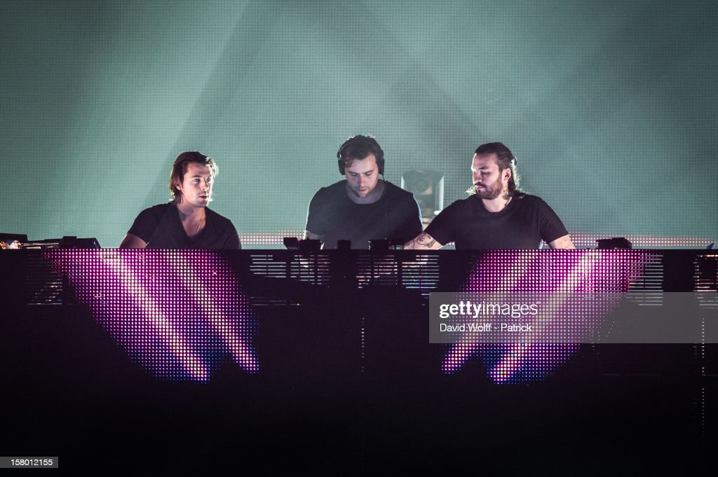 Axwell, Sebastian Ingrosso and Steve Angello from Swedish House Mafia perform at Palais Omnisports de Bercy on December 8, 2012 in Paris, France.