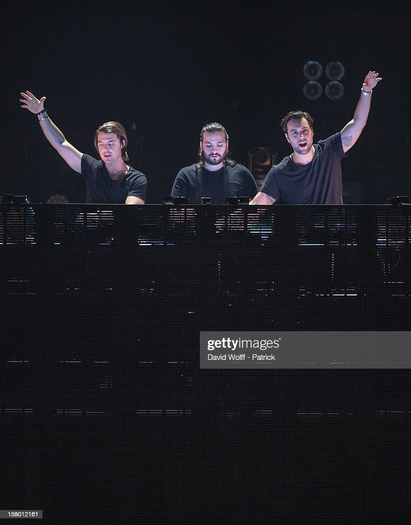 Axwell, Steve Angello and Sebastian Ingrosso from Swedish House Mafia perform at Palais Omnisports de Bercy on December 8, 2012 in Paris, France.