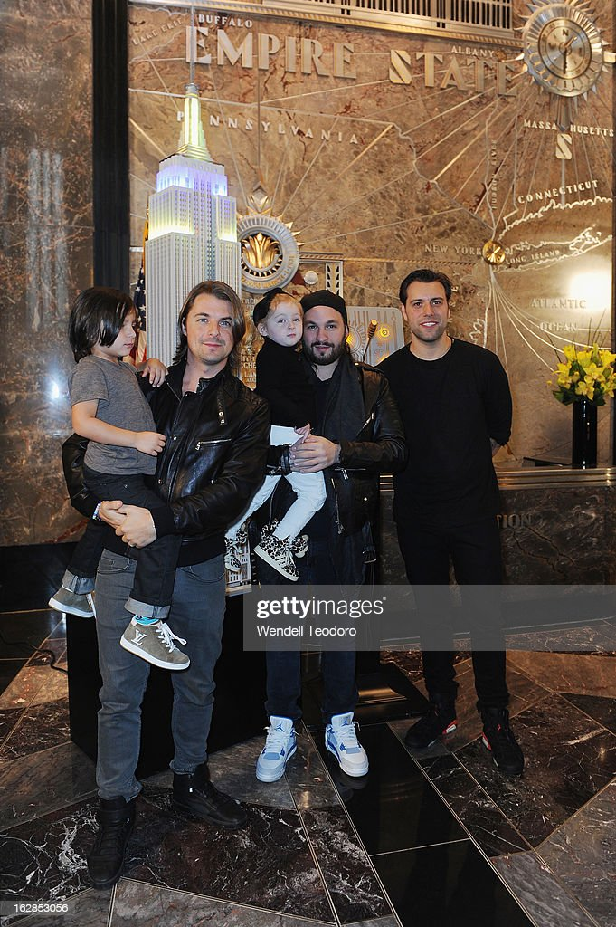 Axwell, Steve Angello and Sebastian Ingrosso of Swedish House Mafia light The Empire State Building on February 28, 2013 in New York City.