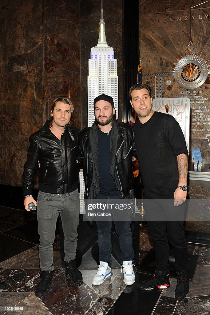 Axwell, Steve Angello and Sebastian Ingrosso of the Swedish House Mafia light The Empire State Building on February 28, 2013 in New York City.