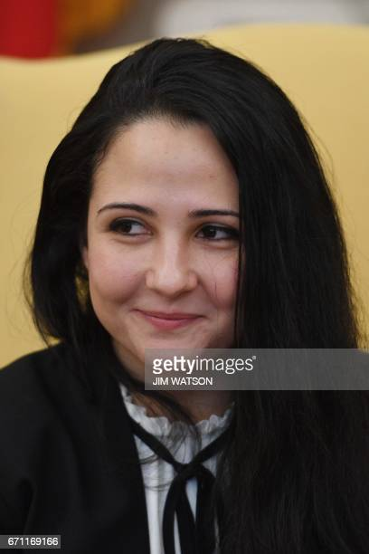 Aya Hijazi an EgyptianAmerican aid worker smiles during a meeting with US President Donald Trump at the White House in Washington DC April 21 2017...