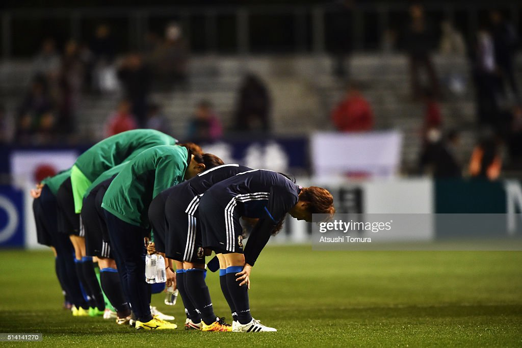 Aya Miyama (R) and Japanese players bow toward their supporters after their 6-1 win in the AFC Women's Olympic Final Qualification Round match between Vietnam and Japan at Kincho Stadium on March 7, 2016 in Osaka, Japan.
