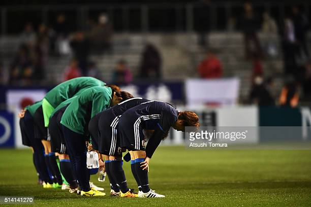 Aya Miyama and Japanese players bow toward their supporters after their 61 win in the AFC Women's Olympic Final Qualification Round match between...