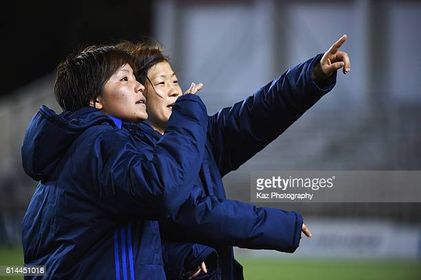 Aya Miyama and Mana Iwabuchi of Japan applaud the supporters after the AFC Women's Olympic Final Qualification Round match between Japan and North...
