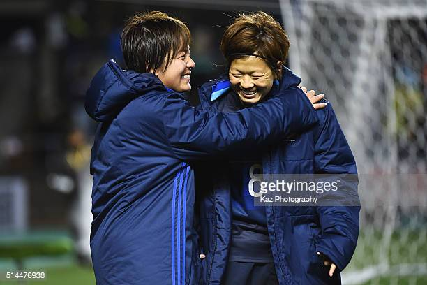 Aya Miyama and Mana Iwabuchi of Japan talk after the AFC Women's Olympic Final Qualification Round match between Japan and North Korea at Kincho...