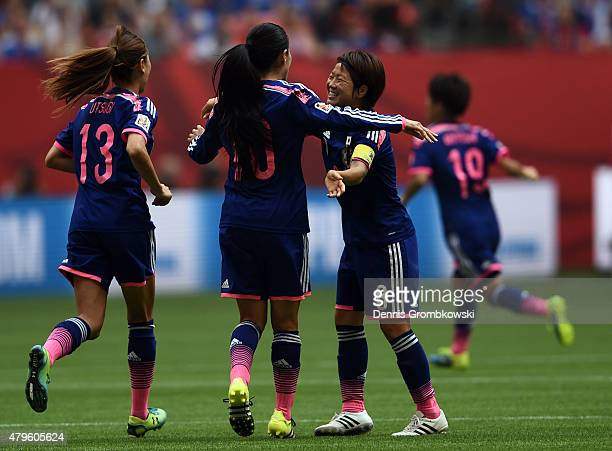 Aya Miyama Homare Sawa and Rumi Utsugi of Japan celebrate after an own goal scored by Julie Johnston of the United States of America in the FIFA...