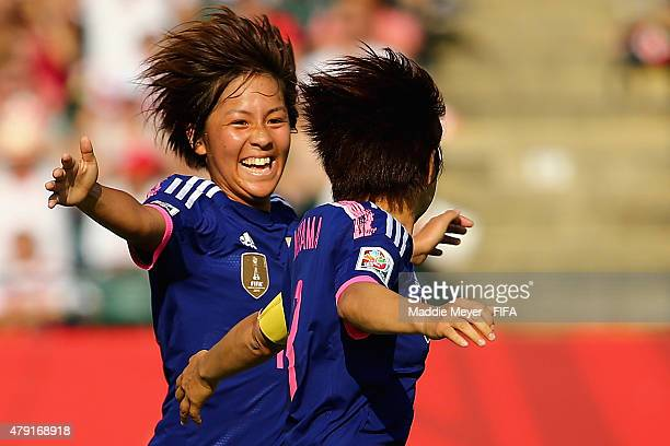 Aya Miyama of Japan and Mana Iwabuchi celebrate their teams second goal during the FIFA Women's World Cup Canada 2015 semi final match between...