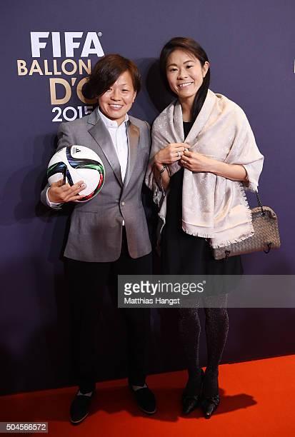 Aya Miyama of Japan and Okayama Yunogo Belle and former Japanese international Homare Sawa are seen during the FIFA Ballon d'Or Gala 2015 at the...