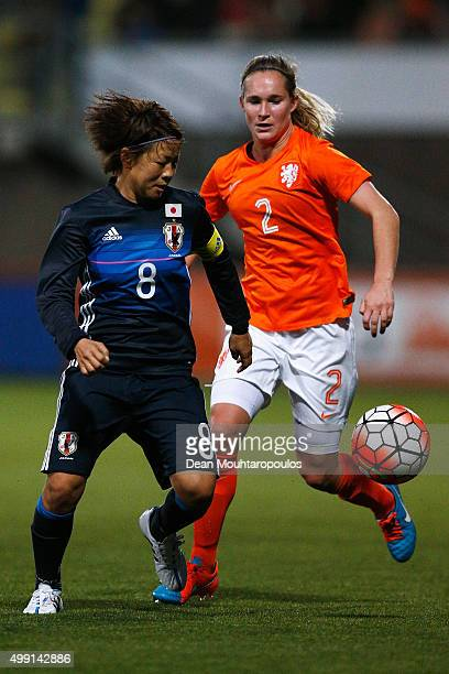 Aya Miyama of Japan battles for the ball with Desiree van Lunteren of the Netherlands during the International Friendly match between Netherlands and...