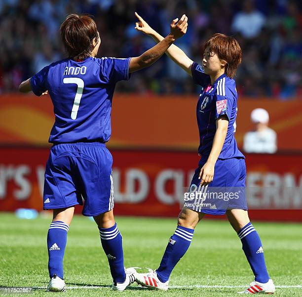 Aya Miyama of Japan celebrates her team's second goal with team mate Kozue Ando during the FIFA Women's World Cup 2011 match between Japan and New...