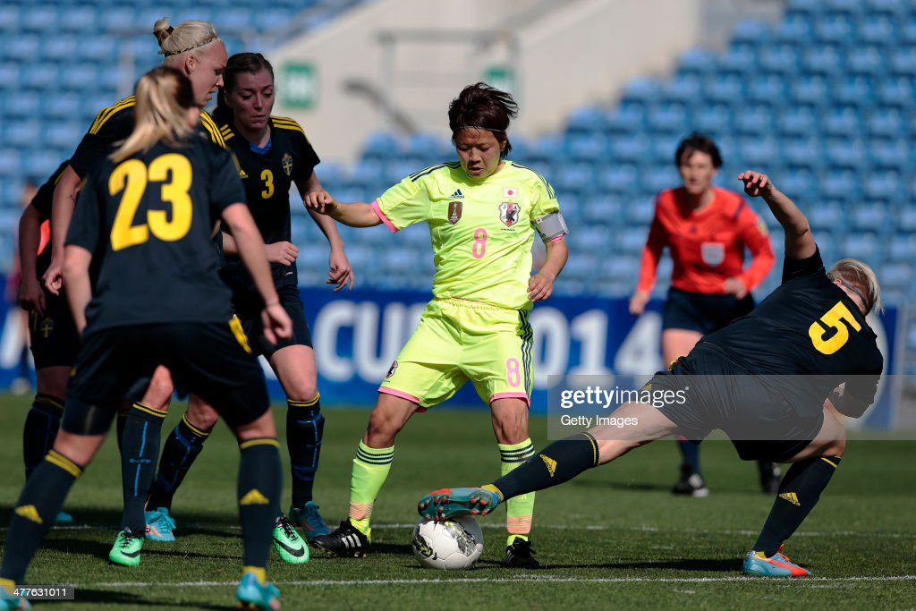 Aya Miyama of Japan challenges Nilla Fischer of Sweden during the Algarve Cup 2014 match between Japan and Sweden on March 10, 2014 in Loule, Portugal.