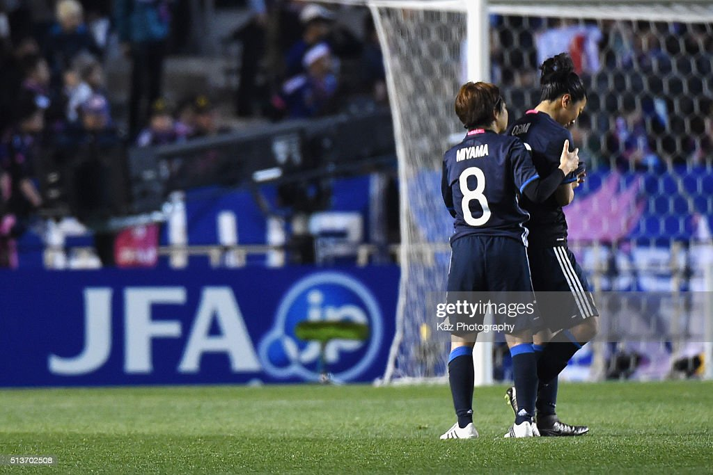 Aya Miyama (L) of Japan consoles her team mate Yuki Ogimi (R) after their 1-2 defeat in the AFC Women's Olympic Final Qualification Round match between Japan and China at Kincho Stadium on March 4, 2016 in Osaka, Japan.