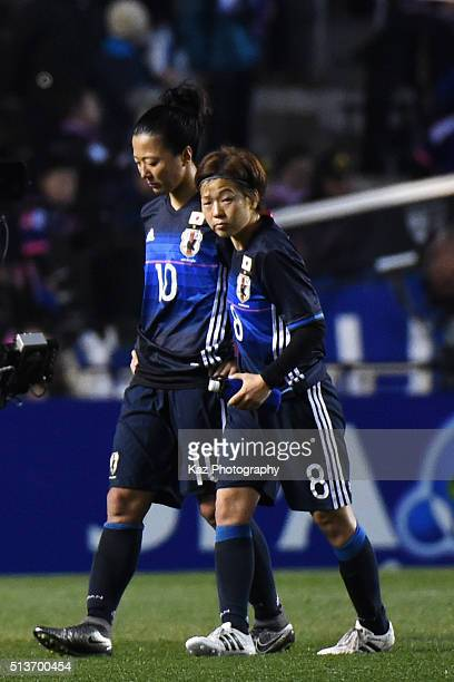 Aya Miyama of Japan consoles her team mate Yuki Ogimi during the AFC Women's Olympic Final Qualification Round match between Japan and China at...