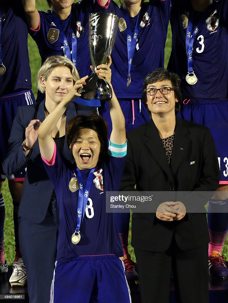 <a gi-track='captionPersonalityLinkClicked' href=/galleries/search?phrase=Aya+Miyama&family=editorial&specificpeople=2524493 ng-click='$event.stopPropagation()'>Aya Miyama</a> of Japan holds the Asian Cup aloft after they defeated Australia in the final of the AFC Women's Asian Cup match between Japan and Australia at Thong Nhat Stadium on May 25, 2014 in Ho Chi Minh City, Vietnam.