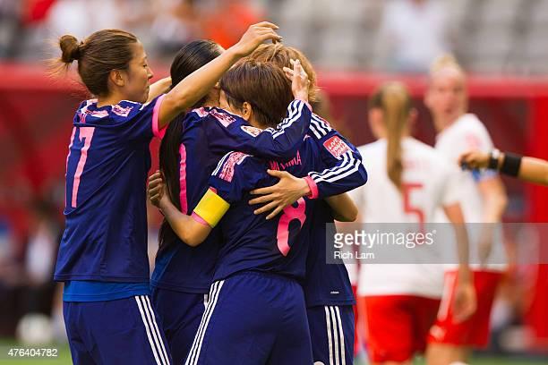 Aya Miyama of Japan is congratulated by teammates Yuki Ogimi and Mizuho Sakaguchi after scoring on a penalty shot against Switzerland during the FIFA...