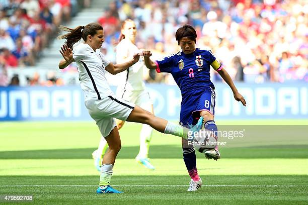 Aya Miyama of Japan with the ball against Tobin Heath of the United States in the first half in the FIFA Women's World Cup Canada 2015 Final at BC...