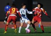 Aya Miyama of Okayama Yunogo Belle battles for the ball with Nahomi Kawasumi and Homare Sawa of INAC Kobe Leonessa during the All Japan Women's...