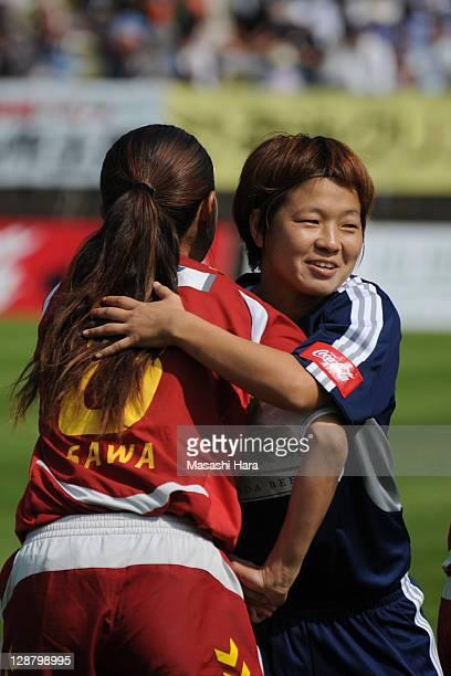 Aya Miyama of Okayama Yunogo Belle hugs Homare Sawa before the Nadeshiko League match between Okayama Yunogo Belle and INAC Kobe Leonessa at Mimasaka...