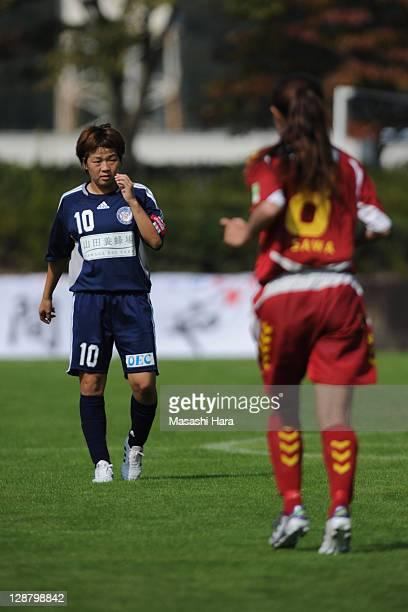 Aya Miyama of Okayama Yunogo Belle looks at Homare Sawa of INAC Kobe Leonessa during the Nadeshiko League match between Okayama Yunogo Belle and INAC...
