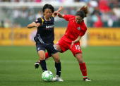 Aya Miyama of the Los Angeles Sol plays the ball from Homare Sawa of the Washington Freedom in the first half during the WPS game at The Home Depot...