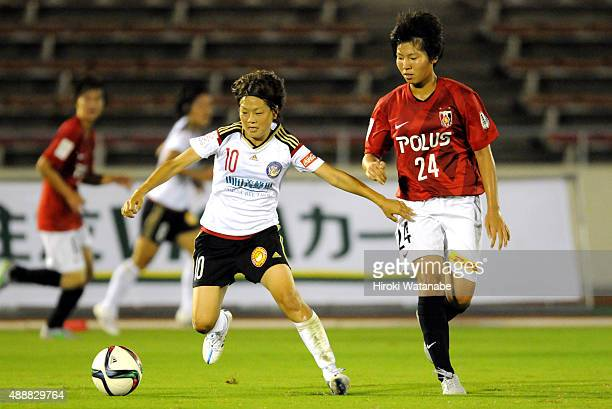 Aya Miyama of Yunogo Belle and Kiko Seike of Urawa Reds Ladies compete for the ball during the Nadeshiko League match between Urawa Red Diamonds...