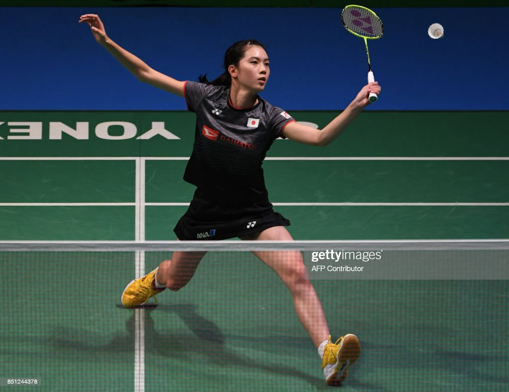 Aya Ohori of Japan hits a return against Chen Yufei of China