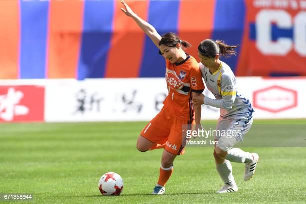 Aya Saeki of Albirex Nigata and Aya Sameshima of INAC Kobe Leonessa compete for the ball during the Nadeshiko League match between Albirex Niigata...