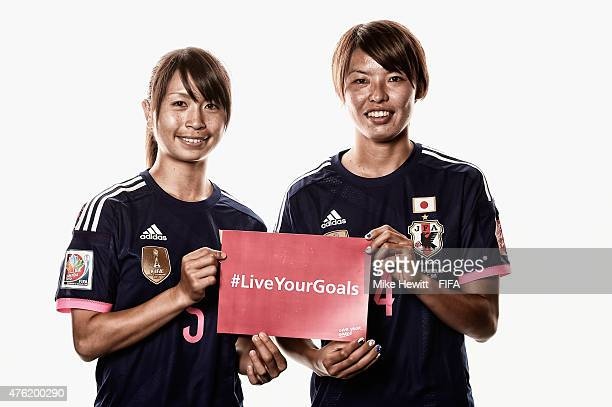 Aya Sameshima and Saki Kumagai of Japan help promote the #Live Your Goals project during the official Japan portrait session ahead of the FIFA...
