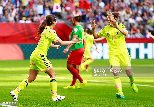 Aya Sameshima and Yuki Ogimi of Japan celebrate Japan's first goal during the FIFA Women's World Cup Canada 2015 Group C match between Japan and...