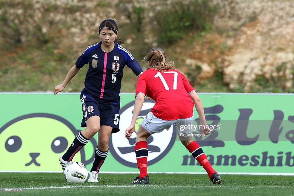 Aya Sameshima DF of Japan challenges Ingrid Ryland DF of Norway during the Algarve Cup match between Japan and Norway at the Complexo Desportivo Belavista on March 6, 2013 in Parchal, Portugal.