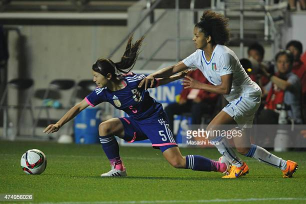 Aya Sameshima of Japan and Sara Gama of Italy compete for the ball during the Kirin Challenge Cup 2015 women's soccer international friendly match...