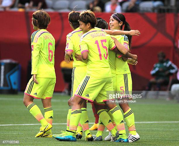 Aya Sameshima of Japan celebrates scoring her team's first goal with her team mates during the FIFA Women's World Cup 2015 Group C match between...